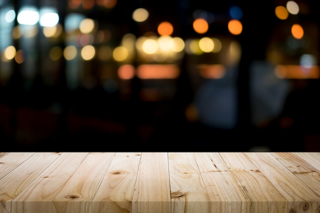 Empty wooden table platform and bokeh at night