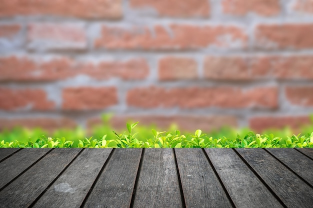 Empty wooden table platform with brick wall background
