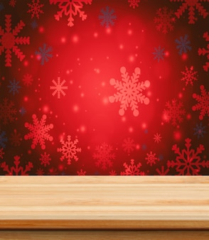 Tavolo di legno vuoto per il posizionamento del prodotto con sfondo della carta da parati di natale