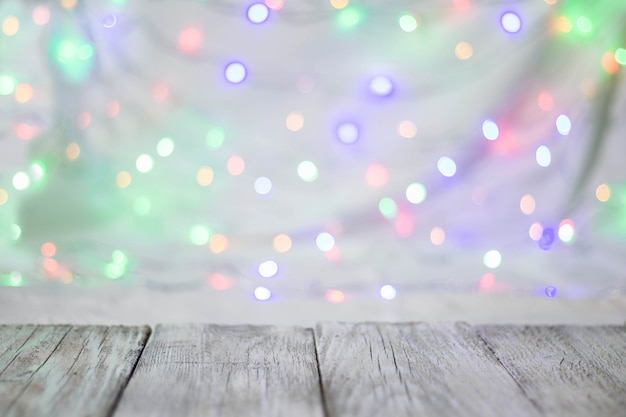 Empty wooden table or shelf wall on colorful bokeh background.