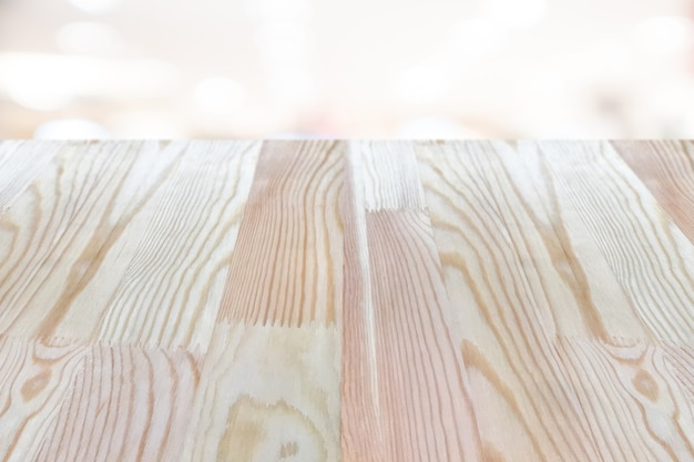 Empty wooden table on top over blur background, can be used mock up for montage products.