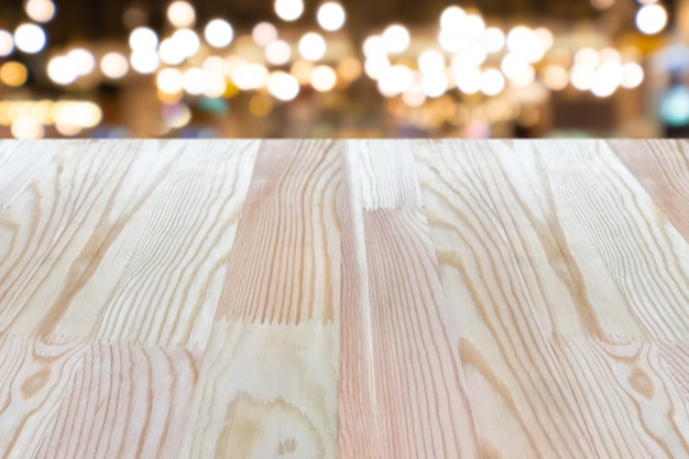 Empty wooden table on top over blur background, can be used mock up