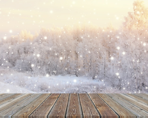 Empty wooden table top on blurred winter backdrop.