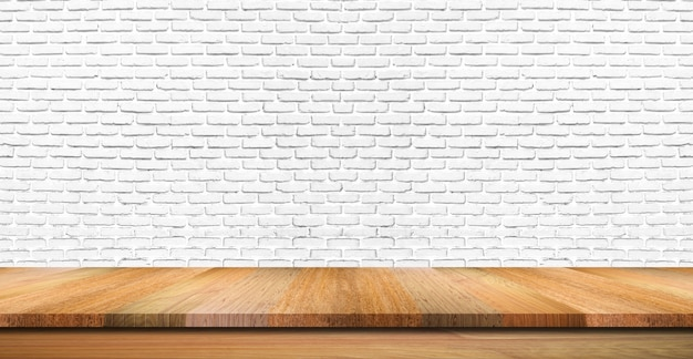 Empty wooden table top, counter or shelf on white brick wall background