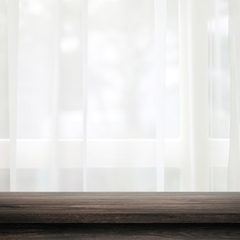 Empty of wooden table top on curtain and window