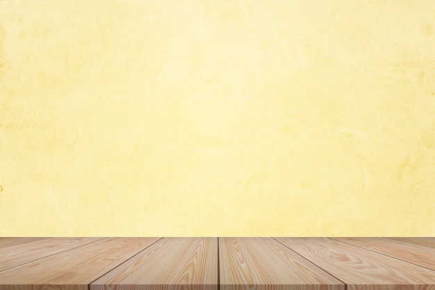 Empty of wooden table top on light yellow pastel color background