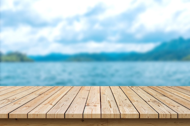 Empty wooden table top on sea background