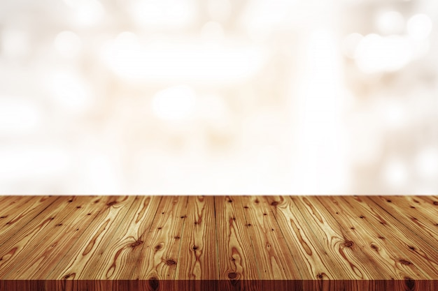 Empty wooden table top with blurred of bokeh coffee shop, cafe, bar background