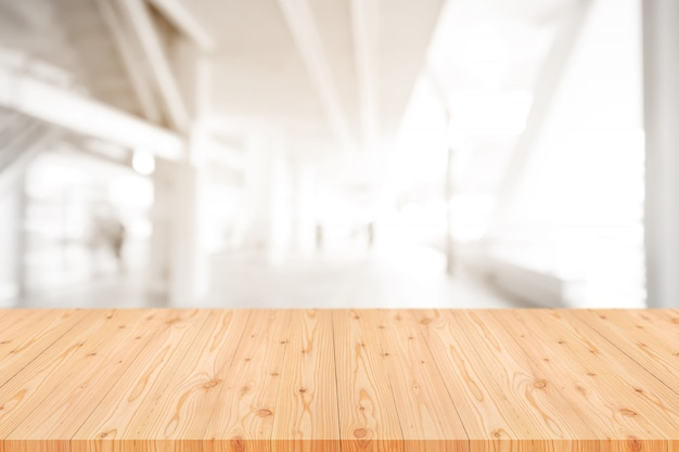 Empty wooden table top with blurred of coffee shop, cafe, bar background