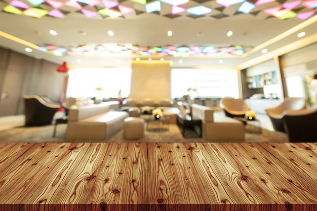 Empty wooden table top with blurred of coffee shop, cafe, bar