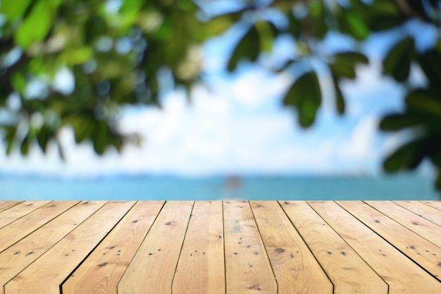 Empty wooden table top with blurred seascape
