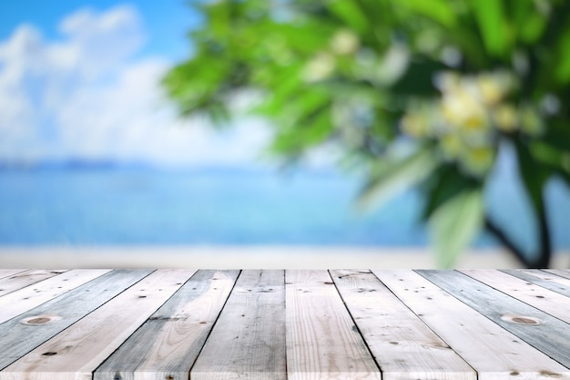Empty wooden table top with tree branch blur background