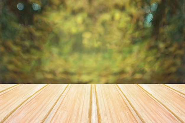 Empty wooden table with blurred city park on background. concept party, products, spring