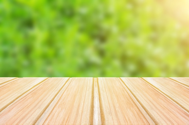 Empty wooden table with blurred green background. concept party, products, spring