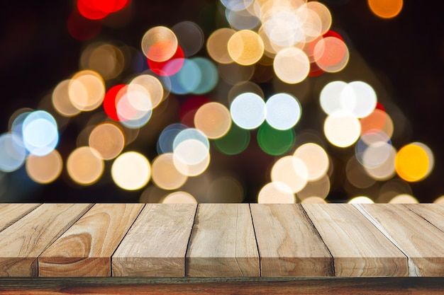 Empty wooden table with blurred ligth bokeh background