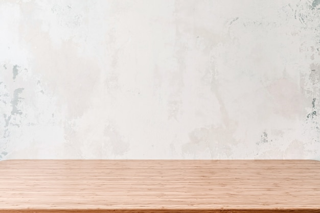 Empty wooden table with grunge cement or concrete wall texture background