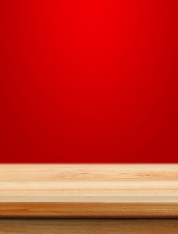 Empty wooden table with red christmas background for product placement with blur christmas wallpaper background