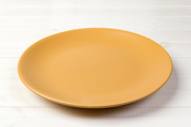 Empty yellow matte plate