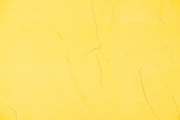 Empty yellow painted textured wall