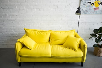 Empty yellow sofa at home