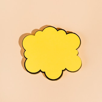 An empty yellow speech bubble on beige background