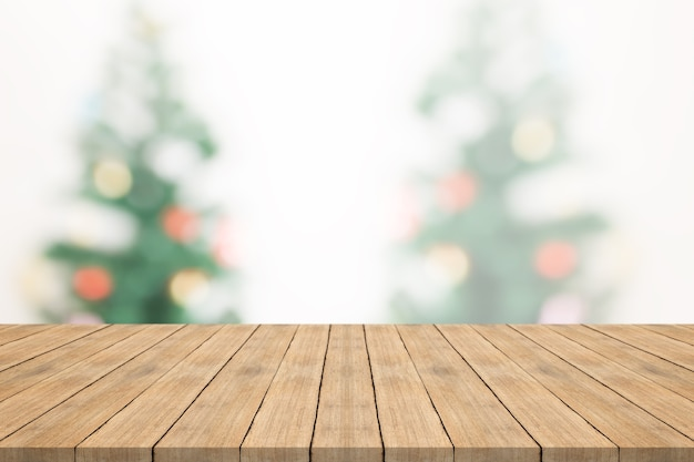 Empyt wood table top on blurred background from christmas tree,space for montage you products