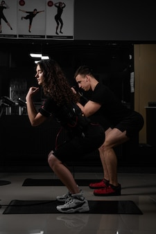 Ems group training for two men and women in the gym