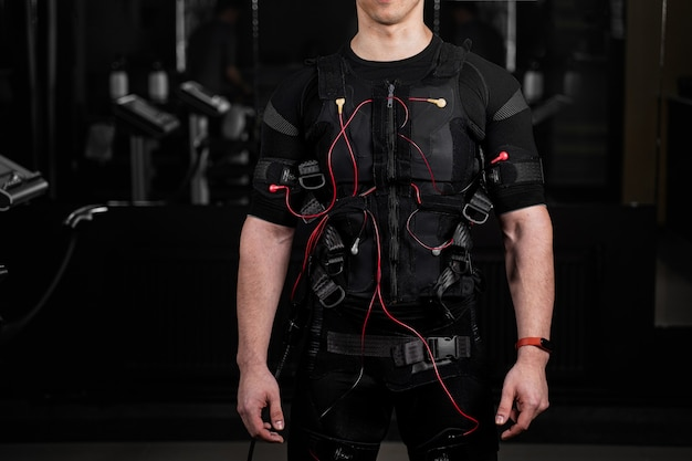 Ems suit with red wires for electro impulse stimulation for body