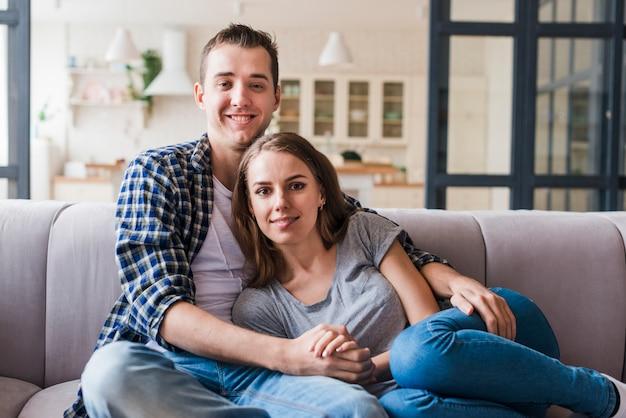 Enamored couple bonding on sofa