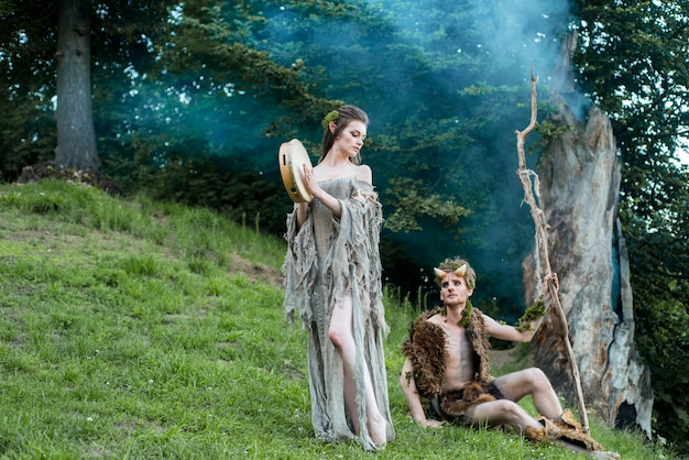 Enamored elves. beautiful fairy girl elf and a guy of the forest king.the concept of chelowin