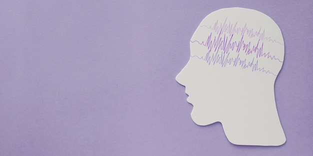 Encephalography brain paper cutout with purple ribbon, epilepsy awareness, seizure disorder, mental health concept