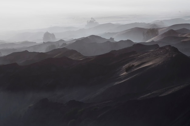 Enchanting view of bromo desert in a foggy morning seen from mount bromo