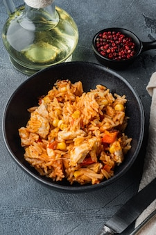 Enchilada with tomato rice, a mexican recipe, on gray