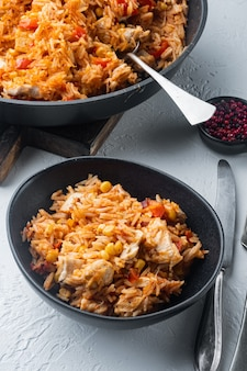 Enchilada with tomato rice, a mexican recipe, on white table