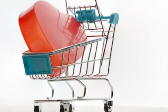 Endless love Valentine's day concept, Red heart in shopping cart, basket supermarket on screen tablet