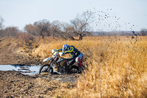 Enduro bike rider stuck in the deep mud