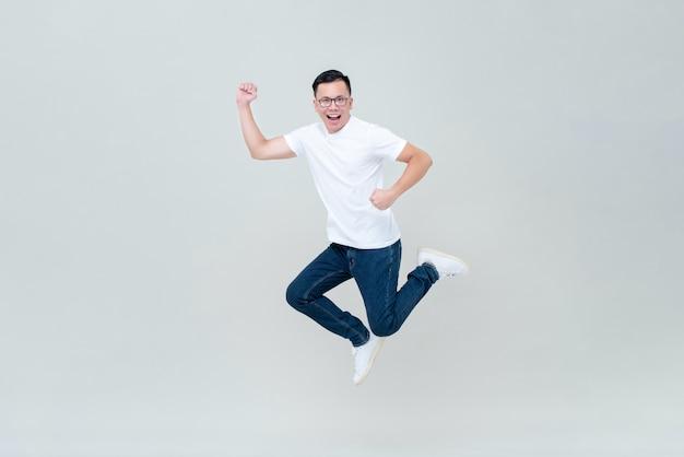 Energetic asian man jumping