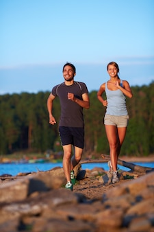Energetic couple jogging in the morning