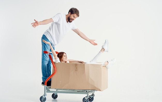 Energetic courier with cardboard boxes transporting heavy cargo light