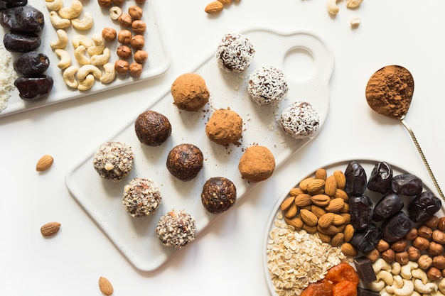 Energy balls with cacao and nuts on white.