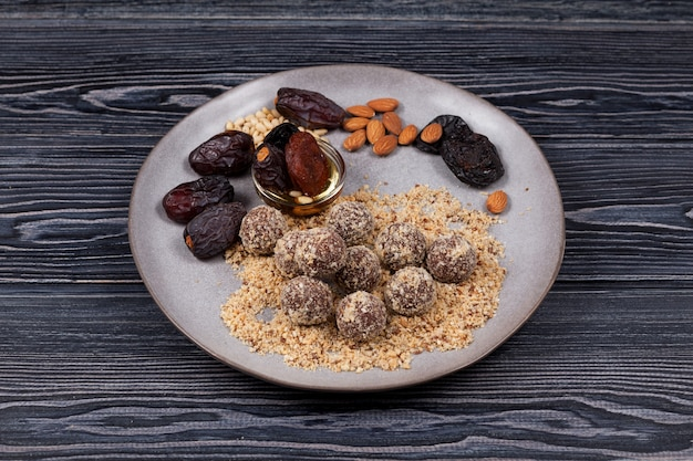 Energy balls with dates sweets proper nutrition homemade on dark background