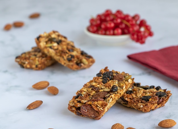 Energy bars of oatmeal, almonds, sunflower seeds, raisins and honey.