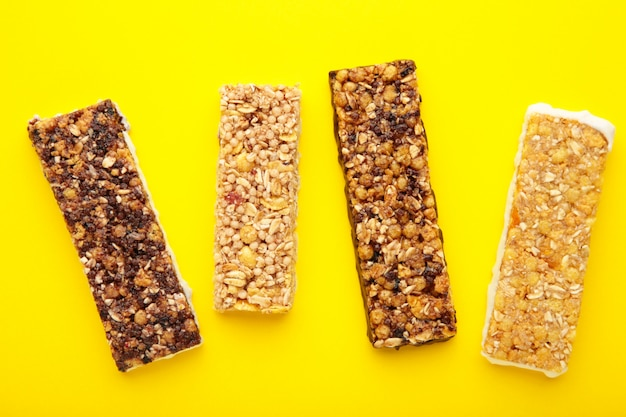 Energy bars - snack for healthy still life on yellow.