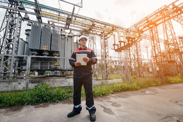 The energy engineer inspects the equipment of the substation. power engineering. industry.