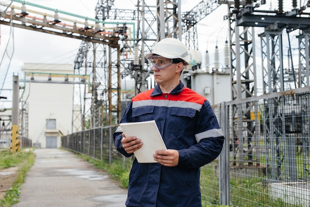 The energy engineer inspects the equipment of the substation