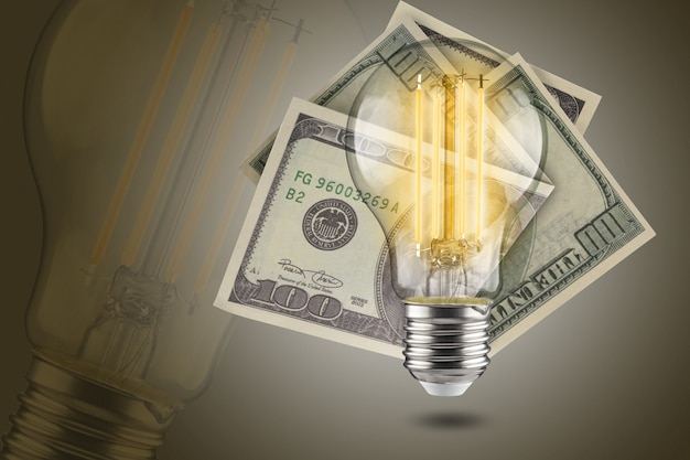 Energy saving concept. led light bulb with dollars on a yellow background.