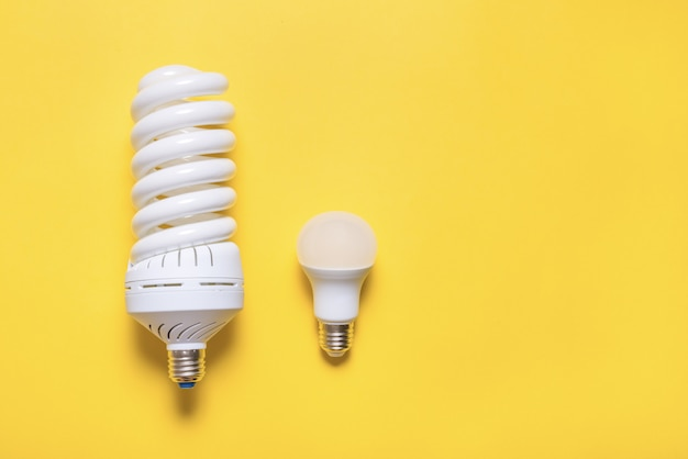 Energy saving lamp on colored background