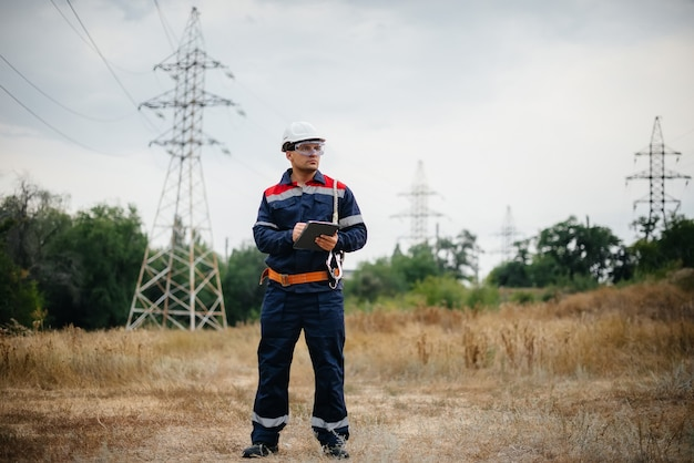 An energy worker inspects power lines. energy.