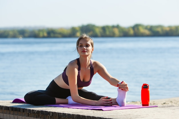 Energy. young female athlete, woman training, practicing outdoors in autumn sunshine