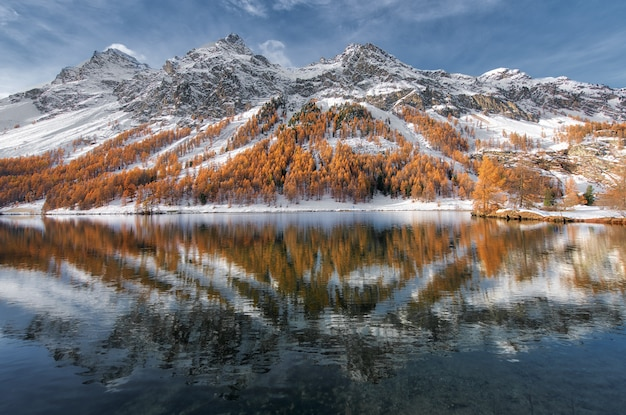 Engadine valley in switzerland. autumn reflection in the lake